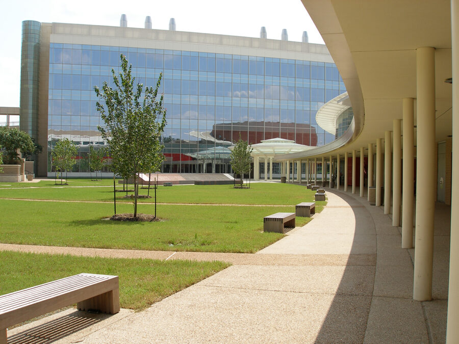 Modern corporate office building in landscaped park with benches